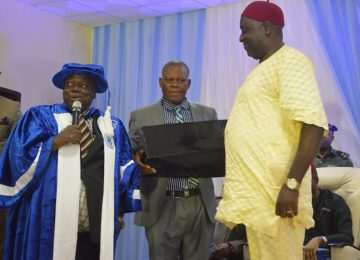 The Rector of the Institute, Prof. Austin Uche Nweze (left); Mr Oliver Odenigbo (middle) while Presenting a gift to the Hon. Speaker of Enugu State House of Assembly, Hon Edward Ubosi (right) after the presentation of the Governor's Lecture at the International Conference Centre, IMT, Campus 3 Enugu.