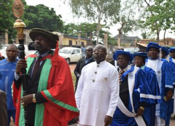 The Mace Bearer, Dr. Tim Adibe leading the procession into the 4th Distinguished Academic Lecture. Behind is the Chairman, House Committee on Education, Hon. Erochukwu Ugwueze; The Rector, Prof Austin Uche Nweze; The Chairman Governing Council, Deaconess Mrs Ifeoma Nwobodo; The Commissioner for Education, Prof. Uchenna Eze and His Excellency, the Lecturer, Rt. Hon. Dr ifeanyi Lawrence Ugwuanyi.