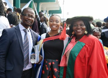 Dr. Ojel Anidi (1st right), Ndidi Otuka (middle) and Barr. Mark Akunna Eze (1st left), Head, Public Relations shortly after the Convocation Ceremony at Okpara Square.