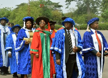 The Permanent Secretary Ministry of Education and Representative of the Commissioner for Education to the Governing Council of the Institute, Mrs. Nwanneka Onah (3rd on the first line) in a procession into the Convocation ground. With her also are members of the IMT Governing Council and Management Staff of the Institute.