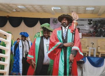 Dr Tim Adibe, the institutes mace bearer while leading the procession to mark the beginning of the matriculation ceremony. Behind is Prof Austin Nweze (Rector) IMT and Mazi Vincent Egbo (Deputy Rector IMT).