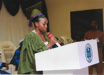 A representative of the Matriculating Student while giving a vote of thanks.