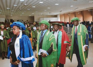 Dr Mrs. Ijeoma C, Aneke (Registrar IMT) first, Barr. (Dr) Christopher C. Igbokwe, Registrar UNN (second), Prof Austin Uche Nweze (Rector IMT) third and Prof. James Ogbonna Deputy Vice-Chancellor, Academic in a procession marking the beginning of the matriculation ceremony.